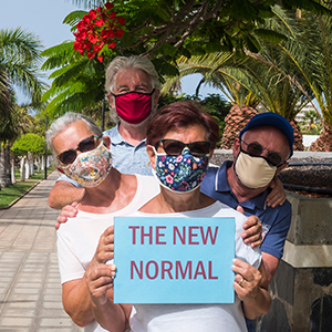 two older couples with masks holding sign encino ca