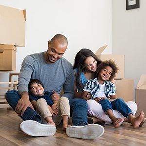 young family sitting on floor surrounded by boxes encino ca
